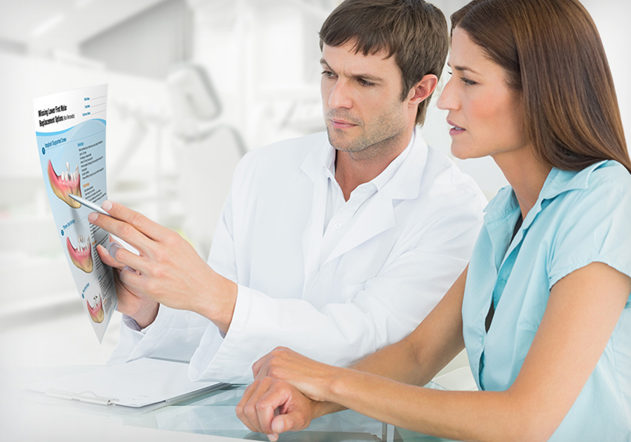 Dentist showing patient Consult-PRO brochures