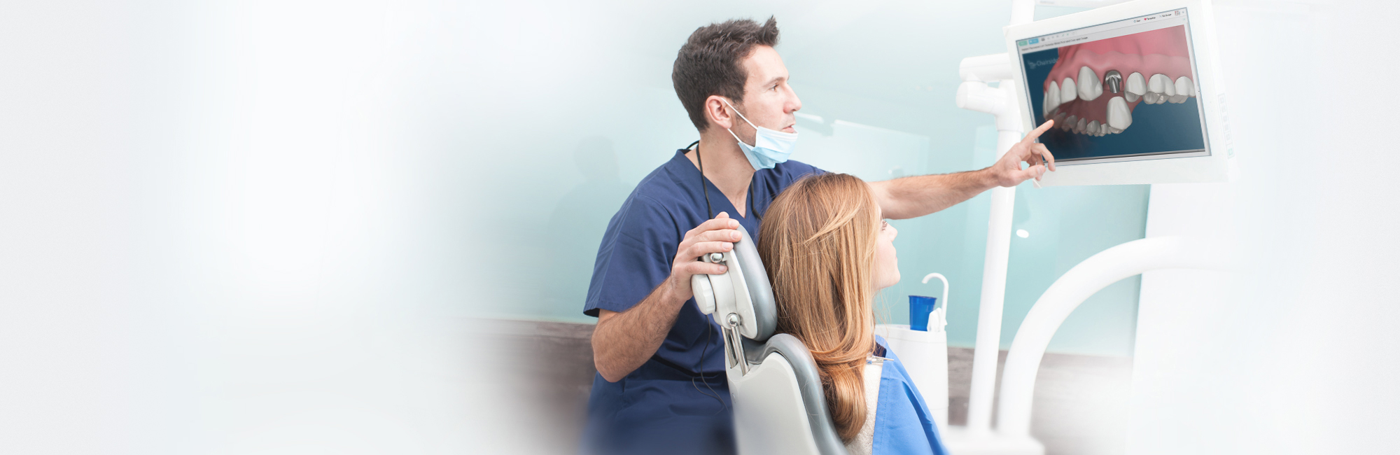 dentist showing dental video software